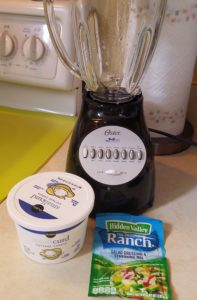 Image of blender, cottage cheese container and powdered ranch dressing mix